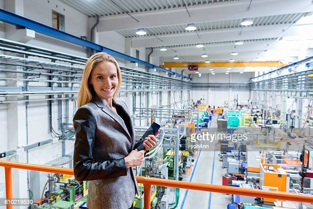 Happy female inspector in factory