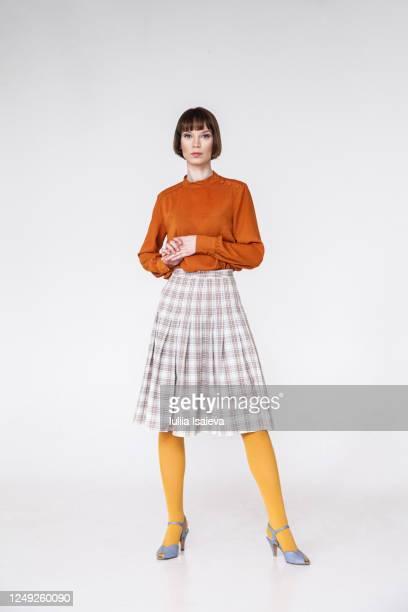 happy female model in retro outfit - スカート ストックフォトと画像
