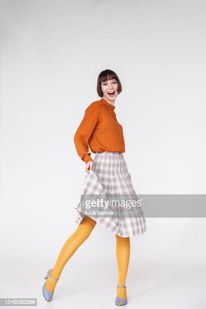 happy female model in retro outfit - full length stock pictures, royalty-free photos & images