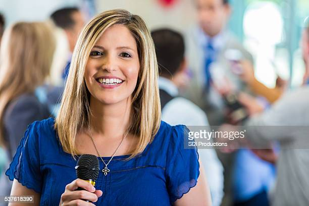 Happy female news reporter