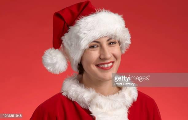 happy female santa - 毛皮の飾り ストックフォトと画像