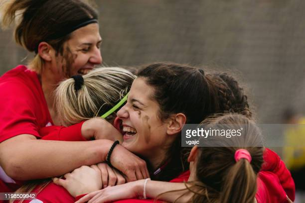 happy female soccer players celebrating goal - team sport stock pictures, royalty-free photos & images