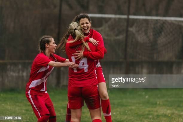 happy female soccer players celebrating goal - soccer competition stock pictures, royalty-free photos & images