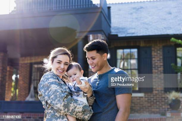 happy female soldier with her family - army stock pictures, royalty-free photos & images