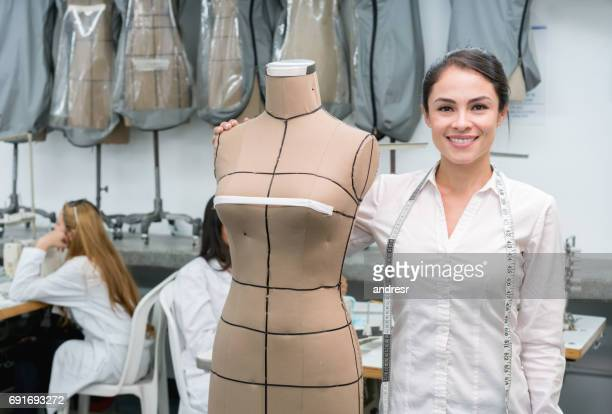 happy female student at a fashion design school - textile industry stock pictures, royalty-free photos & images