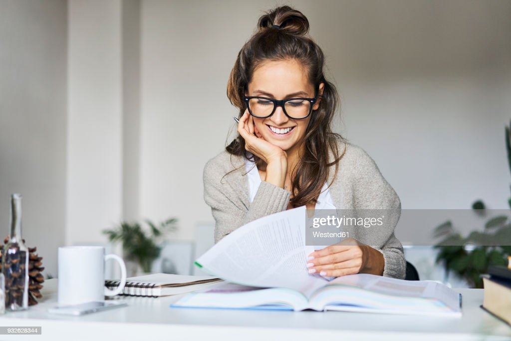 Happy female student learning at home : Stock-Foto