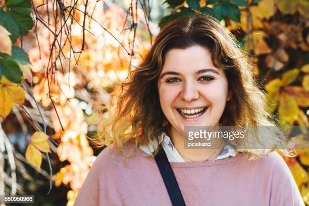 happy female student - chubby teen stock photos and pictures