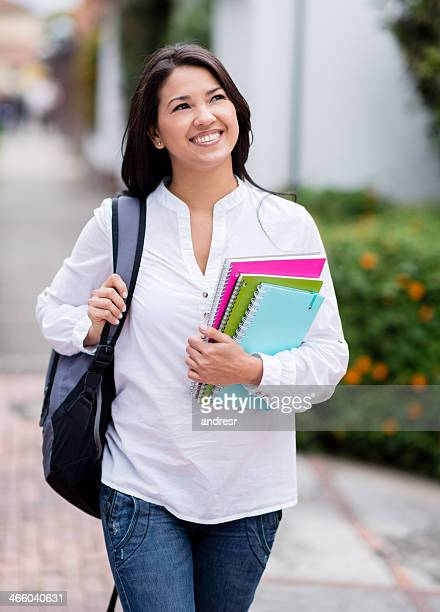 happy female student walking - one young woman only stock pictures, royalty-free photos & images