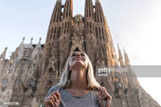 happy female tourist in barcelona looking at the sagrada familia - barcelona spain stock pictures, royalty-free photos & images