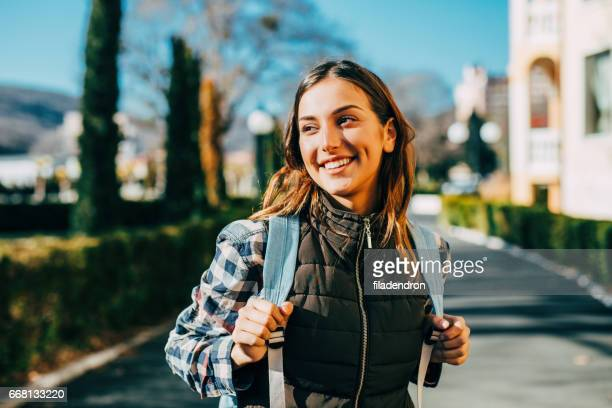 happy female tourist - waistcoat stock pictures, royalty-free photos & images