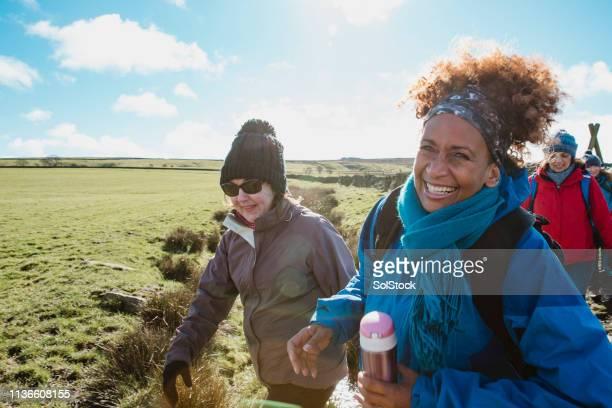 happy female walkers - vita attiva foto e immagini stock