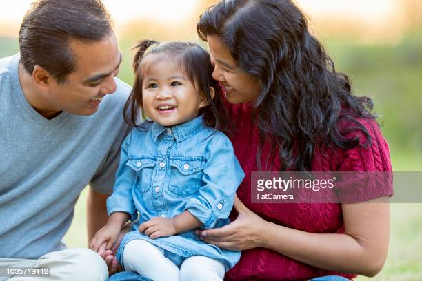 happy filipino family of three - golden hour stock pictures, royalty-free photos & images