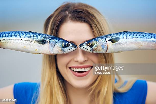 happy fisher woman - mackerel stock pictures, royalty-free photos & images