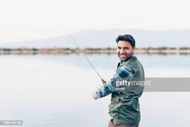 happy fisherman - simple living stock pictures, royalty-free photos & images