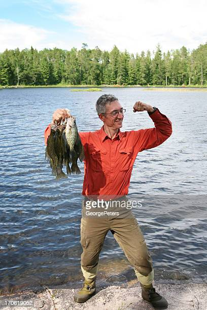 happy fisherman - crappie stock pictures, royalty-free photos & images