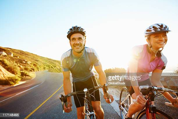 A happy fit couple riding their bicycles