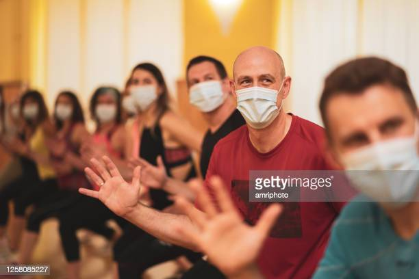 happy fitness group with mouth nose masks - medium group of people stock pictures, royalty-free photos & images