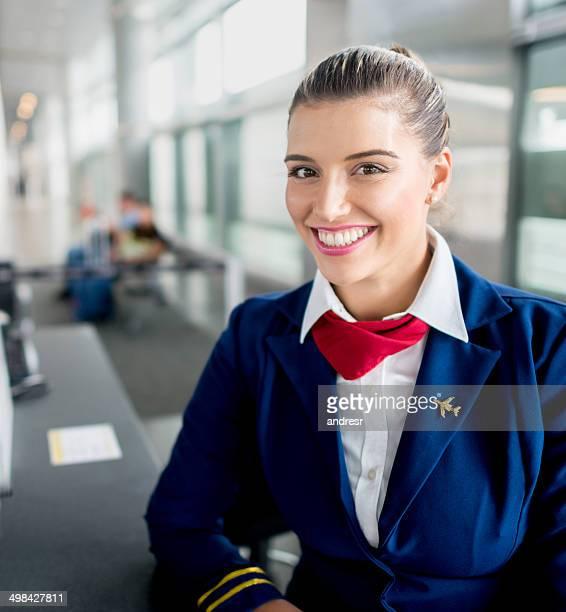 Happy flight attendant