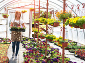 woman working at greenhouse