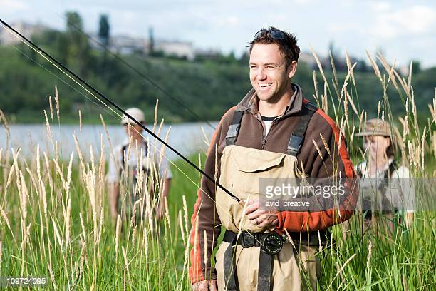 Happy Fly Fisherman With Friends