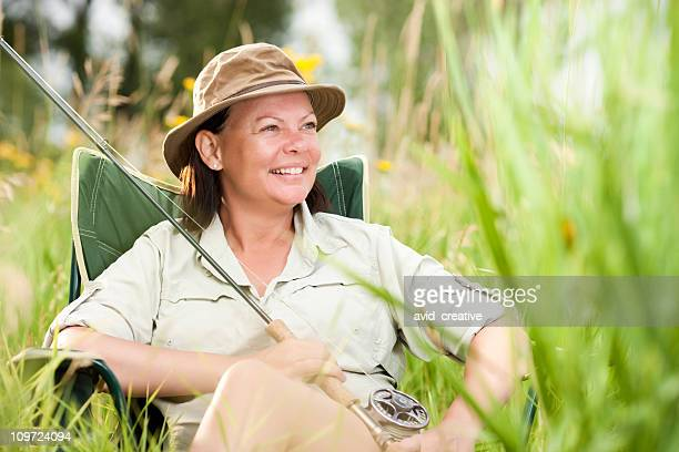 Happy Fly-Fisher Woman Relaxing In Chair