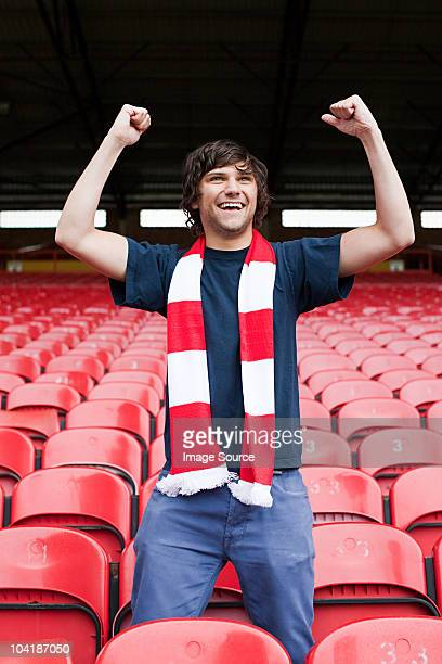 happy football fan in empty stadium - football fan stock photos and pictures