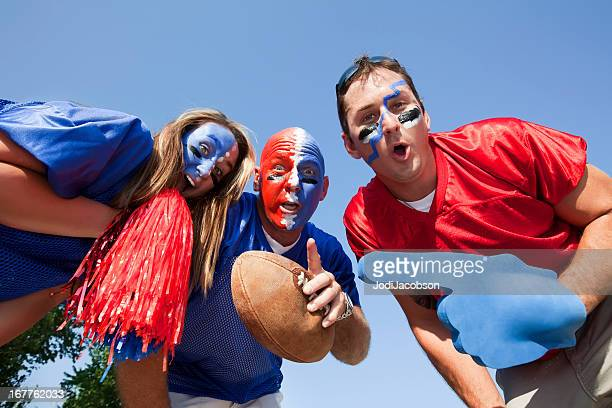 happy football fans celebrating and tailgating - football body paint stock photos and pictures
