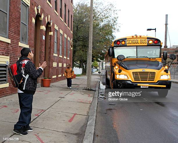 A happy fourth grader William Candelario left reacts as a late school bus due to arrive at 905 am pulled up at 925 am near the corner of Quincy and...