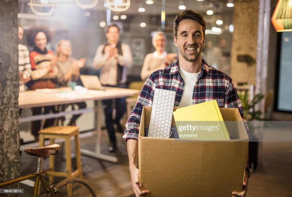 Happy freelancer leaving the office satisfied after quitting job. : Stock Photo