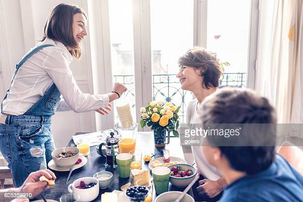 happy french family having breakfast together