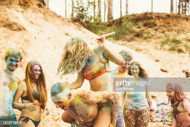 happy frieands having fun. festival holi. - spirituality stock pictures, royalty-free photos & images