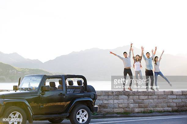 Happy friends and jeep