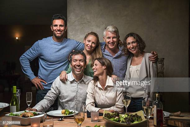 Happy friends at dining table