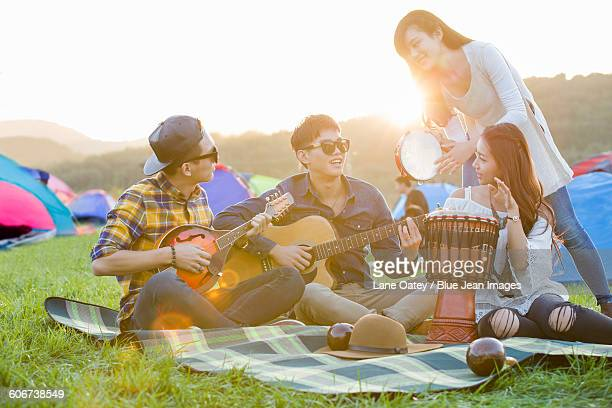 happy friends at music festival - chinese music stock pictures, royalty-free photos & images