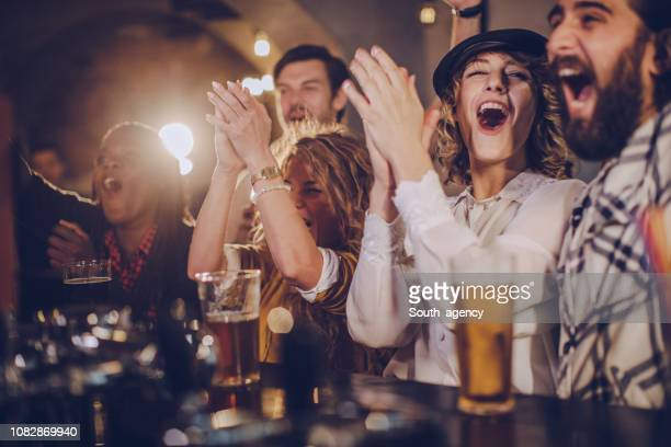 happy friends at the bar - pub stock pictures, royalty-free photos & images