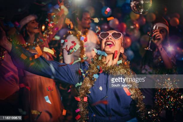 happy friends celebrating new year - carnival stock pictures, royalty-free photos & images