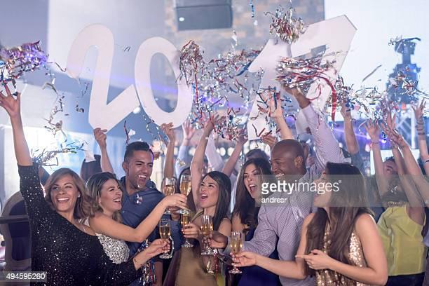 Happy friends celebrating New Years 2017