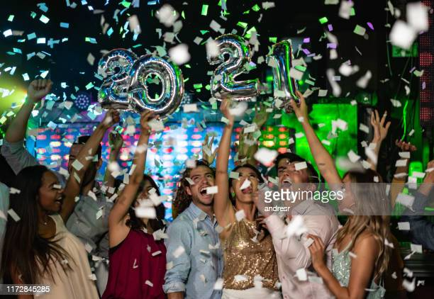 happy friends celebrating the new year 2021 - 2021 stock pictures, royalty-free photos & images
