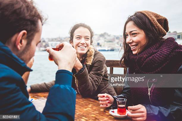 Happy friends drinking tea in a cafe