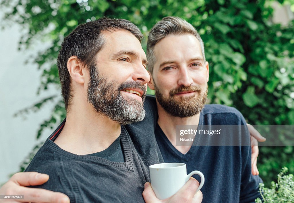 Happy friends embracing each other : Stock Photo