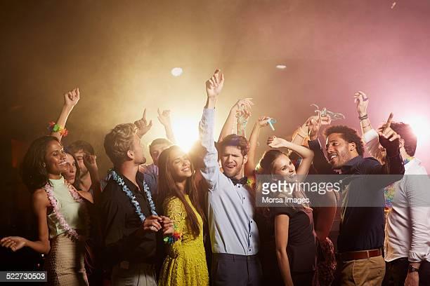 happy friends enjoying at nightclub - party imagens e fotografias de stock