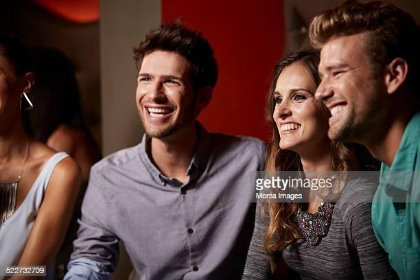 Happy friends enjoying at nightclub