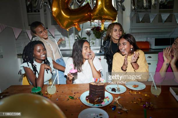 happy friends enjoying birthday at home - 21st birthday stock pictures, royalty-free photos & images