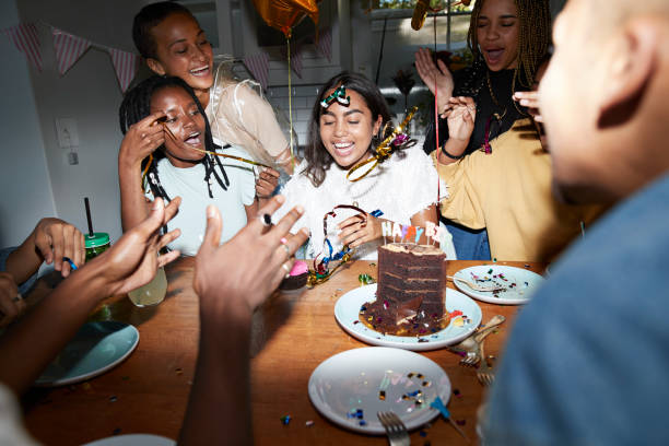 happy friends enjoying birthday at home - best friend birthday cake stock pictures, royalty-free photos & images
