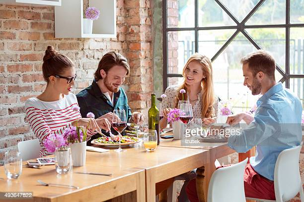 Happy friends enjoying dinner in the restaurat