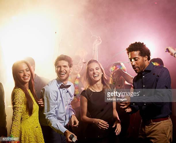 Happy friends enjoying on dance floor