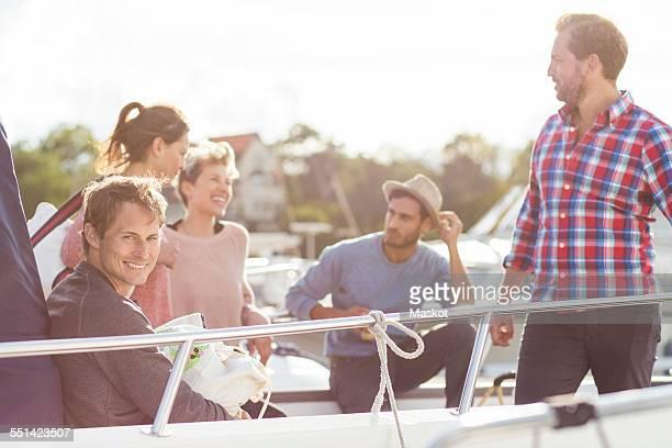 Happy friends enjoying on yacht