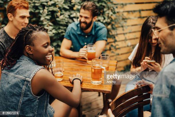 happy friends having a great time at the pub - brewery stock pictures, royalty-free photos & images