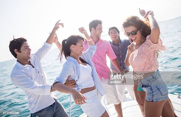 Happy friends having boat party
