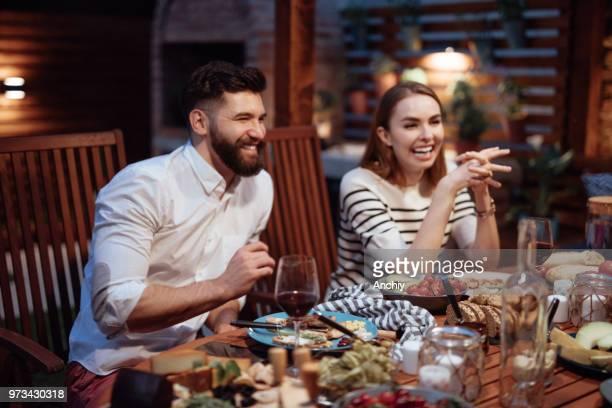 Happy friends having fun an drinking wine